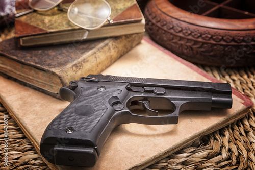 Set of ancient books , whiskey, casino dice and cards with handgun