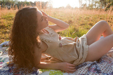 Pretty Woman in Field at Sunset