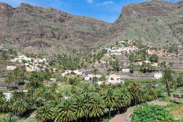 Villages and small towns in the Valle Gran Rey on la Gomera. Terraced fields and date palms is a typical landscape for the Valle Gran Rey, the beautiful canyon on the Canary island La Gomera.