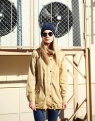 Fashion pretty blonde model girl over urban background