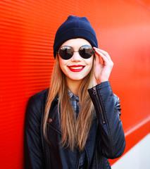 Portrait smiling blonde woman wearing fashion rock black style o