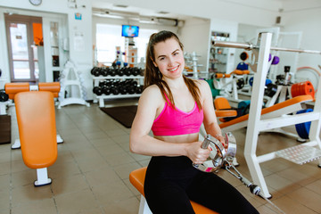 Beautiful athletic woman at the gym