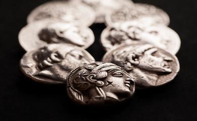 Ancient greek silver coins closeup macro shot