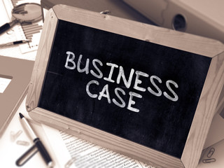 Business Case Handwritten by White Chalk on a Blackboard. Composition with Small Chalkboard on Background of Working Table with Office Folders, Stationery, Reports. Blurred, Toned Image. 3D Render.