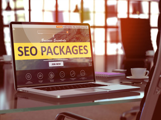 SEO - Search Engine Optimization - Packages Concept. Closeup Landing Page on Laptop Screen  on background of Comfortable Working Place in Modern Office. Blurred, Toned Image. 3D Render.