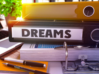 Dreams - Black Office Folder on Background of Working Table with Stationery and Laptop. Dreams Business Concept on Blurred Background. Dreams Toned Image. 3D.