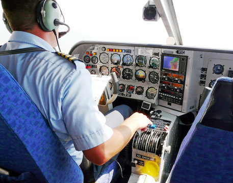 pilot busy with  flyig small plane