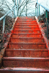 Red stairs.Abstract image of horror stairway covered with  blood-like red paint.