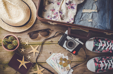 Travel preparations on wooden table