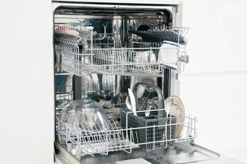 Open dishwasher with the dishes inside