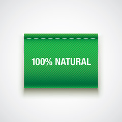 """100% Natural"" printed on a green fabric label."