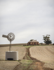 Rural Farm scene with windmill and old farm house