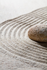 Acrylic Prints Stones in Sand zen sand still-life - textured stone on sinuous waves for concept of relaxation or meditation in beauty or spirituality, closeup