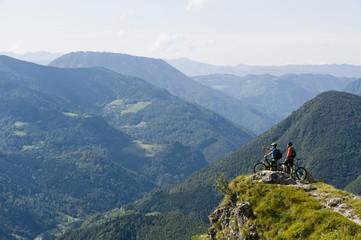 Slovenia, Istria, Slatnik, two mountain bikers looking at view