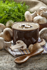 Cream soup with mushrooms champignon in bowl, vintage style