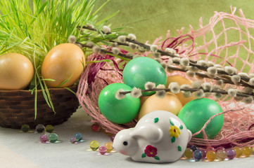 Easter composition. Painted eggs willow and rabbit