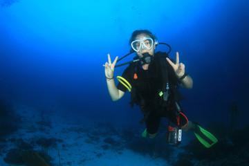Scuba diver exploring coral reef
