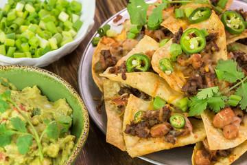 Mexican food. Nachos, guacamolle dip.