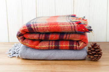 Winter fashion clothing and blanket with wood background