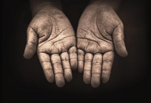 hand of child beggar