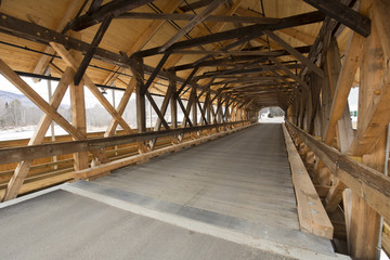 Interior beams of historic wooden covered bridge, Stark, New Hampshire.