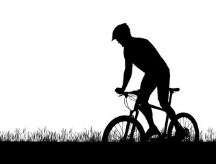 Silhouette of a cyclist on a mountain bike isolated on white background.