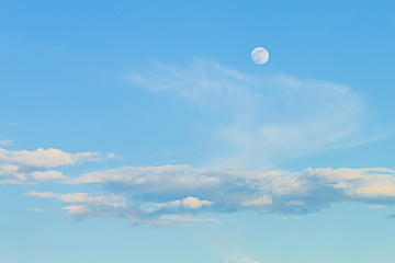It is White cloud and blue sky with the moon