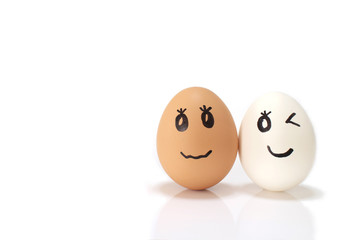 white and brown egg couple in the white