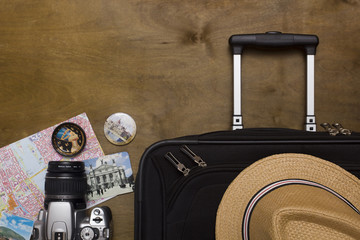 Traveler's suitcase with  equipment with camera and pictures