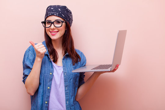 portrait of a young woman with laptop