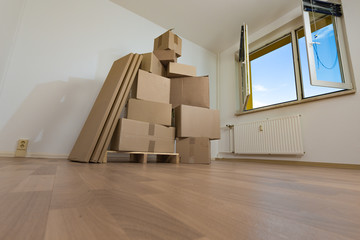 Moving to a new apartment,  boxes in an empty room