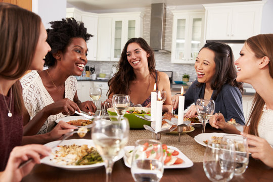 Group Of Female Friends Enjoying Dinner Party At Home