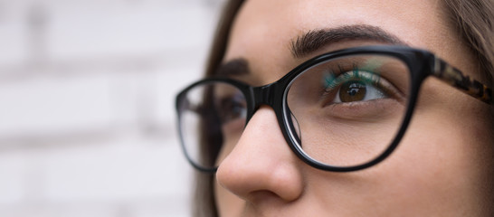 Close up of a young woman wearing glasses