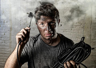 untrained man cable suffering electrical accident with dirty burnt face in funny shock expression