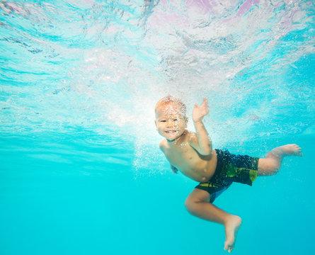 Boy swims underwater