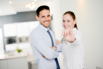 real estate business agent handing out house key of a new apartment