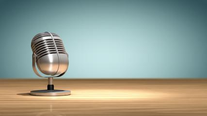 Microphone vintage posé sur une table en bois, orienté et prêt pour enregistrer