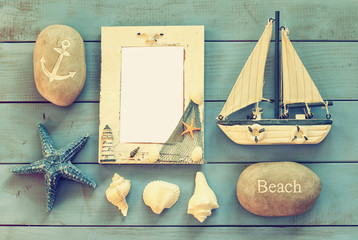 wooden nautical frame and sailing boat on wooden table. nautical lifestyle concept. template, ready to put photography