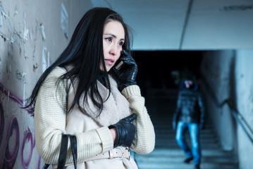 Young woman along at night at a danger