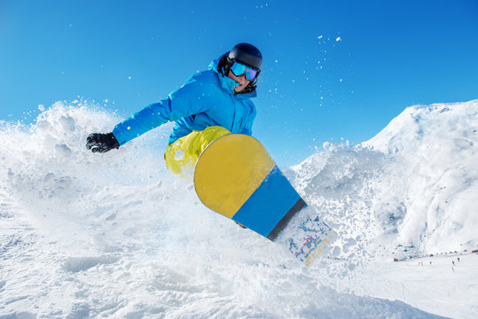 Active snowboarder jumping