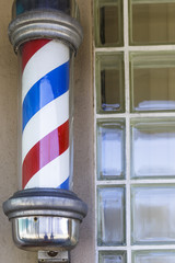 barber pole outside small town barber shop