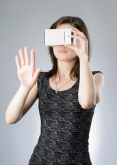 Young woman playing a virtual reality glasses
