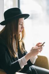 Beautiful woman using her mobile