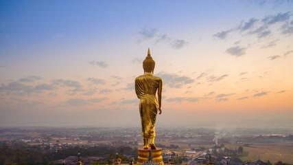 Buddha standing on a mountain Nan Province, Thailand