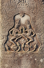 Historic Khmer bas-relief with dancing Hindu goddesses