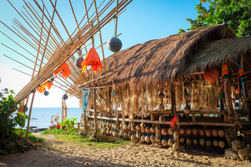 Big bamboo hut build for eating and relaxing in front of the sea at a beach in koh lanta, thailand