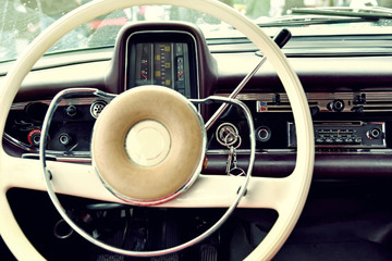 Fragment of interior retro car with speedometer, toggle switches