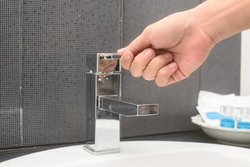 men's hand opening water tap