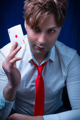 man with ace of diamonds in hand