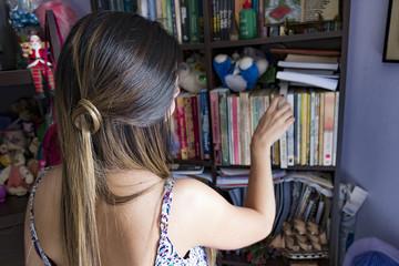 Cute girl choosing a book